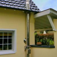 Примеры работ по установке стальных модульных дымоходов в загородном доме