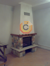 Воздушное отопление дома на базе каминной топки Spartherm
