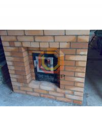 Установка банной печи Kastor c кирпичной кладкой вокргу топливного канала
