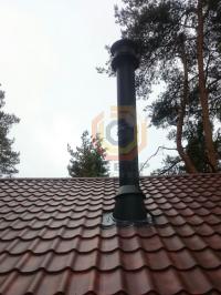 Установка дымоходной системы Schiedel Black над угловым камином