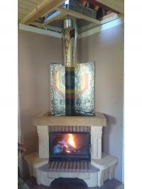 Установка стального дымохода на каминную топку