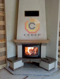 Воздушное отопление дома на базе каминной топки Keddy в угловом исполнении короба камина