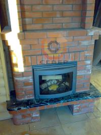 Воздушное отопление дома на базе каминной топки Keddy в кирпичной облицовке