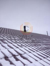 Монтаж дымоходной системы Schiedel Permetr Black внутри загородного дома