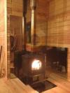Установка печи-камина Jotul F8  в загородном доме с дымоходом из нержавеющей стали