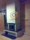 Воздушное отопление дома на базе каминной топки Keddy в авторской облицовке из натурального камня