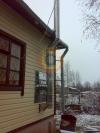 Монтаж дымохода из нержавеющей стали по фасаду загородного дома