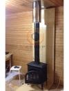 Установка печи-камина Jotul F3 TD BP  в загородном доме с дымоходом из нержавеющей стали