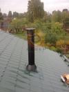 Монтаж дымоходной системы Schiedel Black внутри загородного дома